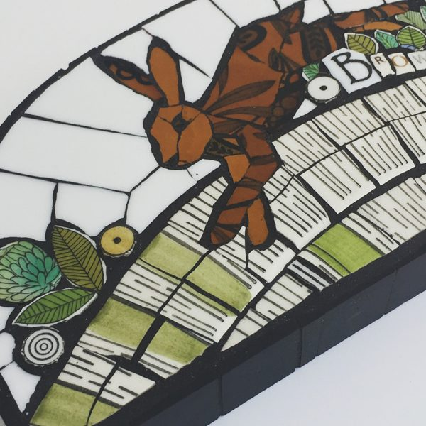 Mosaics made using pattern and colour from old British china and coloured glass.