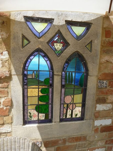 I use stained glass and glass enamel combined with print, painting, photographs and often wood and found objects to create one off panels, sculptures, lamps, windows and jewellery.