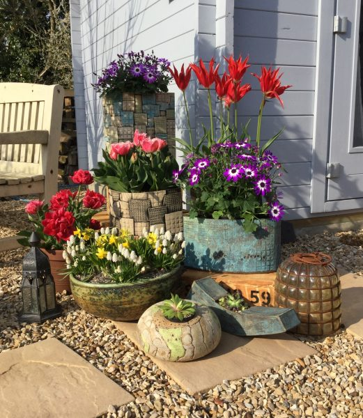 Dee Hunt combines her love of gardening with her ceramic skills. Her stoneware planter designs are frost resistant and make a strong focal point for beautiful outdoor spaces.