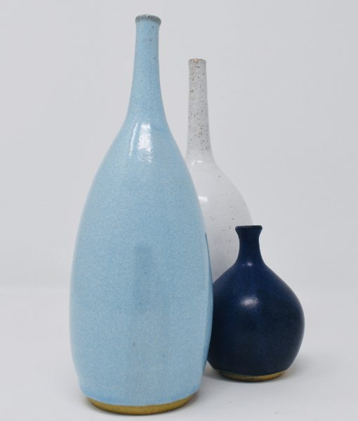 Over the last year I have experimented with throwing bottle forms in all shapes and sizes. I love their elegant curves, echoing this simplicity with a limited glaze palette.