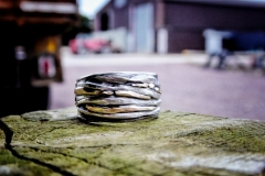 By Carol Clift - Hand beaten silver ring with 18ct yellow gold detail.