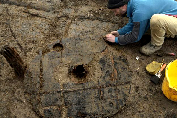Archaeologists digging at a site at Whittelsey, Cambridgeshire have uncovered some of the most remarkable wooden artefacts found in recent years. One of the oldest near complete Bronze Age wheels has been found near to the remains of a horse on a site likened to a Bronze Age Pompeii, BBC journalists report.