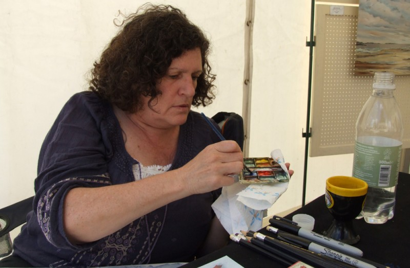 Former PAOS artist Lynne Collins can be seen sketching in the city centre and in the Green Backyard.