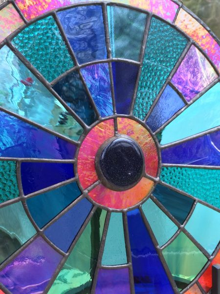 Influenced by the play of light on pattern and colour , I design vibrant glass designs using copperfoil and leadwork construction. Stained glass tuition is available at my Studio.