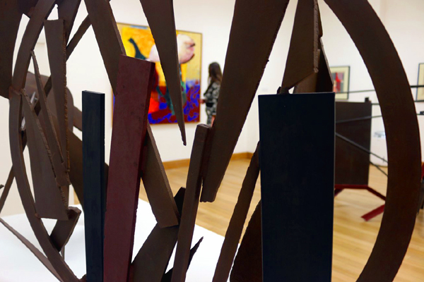 """Anthony Caro & Sheila Girling: A 64 Year Conversation About Art   City Gallery, Peterborough Museum, 27April -21 July 2018  Peterborough Museum and City Gallery presentworks by internationally renownedsculptor Sir Anthony Caro and modernist painter Sheila Girling. Spanning the duration of hiscareer from the60'sto early 2000's, the exhibition includes Caro's iconic large scale abstractmetal works in block colour, smaller table pieces which he began to work on after his larger works and paper sculptures. Exhibited alongside will be paintings by Sheila Girling. Distinguishable by her intense hues in acrylic, her work balances between figuration and abstraction.  [caption id=""""attachment_4636"""" align=""""alignleft"""" width=""""800""""] Anthony Caro and Sheila Girling exhibiting together in Peterborough Museum and Art Gallery 2018. Photography by Tony Nero[/caption]  Caro and Girling met at the Royal Academy in 1948 when he used her drawing board by mistake.Their arguments about art apparently started at that first encounter and within six months they were married. Girling's use of colour proved to be hugely influential on Caro, who was more interested in form than colour.Perhaps his most well known pieceEarly One Morningwasoriginally painted green until Girling suggested that he change it to red.  Viviacity says: 'We are very proud of our new exhibition Anthony Caro & Sheila Girling: A 64 Year Conversation About Art which has just opened at Peterborough Museum & City Gallery. For the first time ever the work of the late Anthony Caro and his wife, modernist painter Sheila Girling are displayed in the same gallery space. The artists work have been shown all over the world, are part of major art collections and both individuals are internationally renowned in their own right.'  Don't miss out on this extraordinary show, which continues until 21 July.      Address:Priestgate, Peterborough PE1 1LF                        Phone:01733 864663          What the paper says...  [caption id=""""att"""