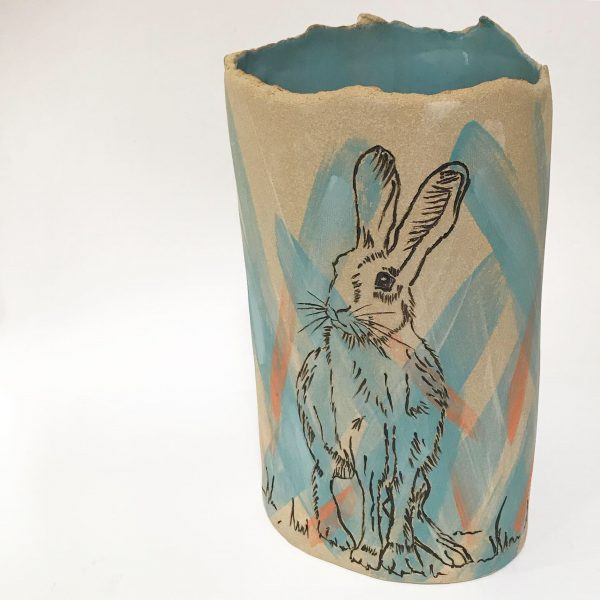Debbie creates individual handbuilt ceramics and uses them as a canvas for her love of drawing decorating them with a variety of methods including coloured slips, underglazes and sgraffito.