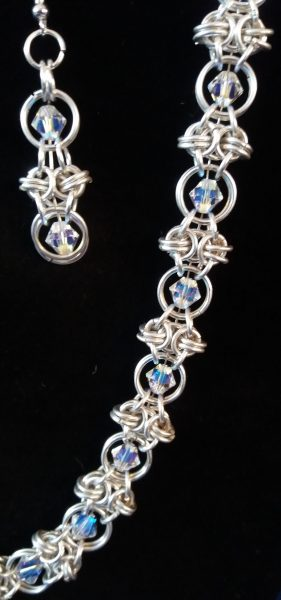 I create jewellery with a combination of chain maille, wire work, beads and crystals, all with a modern twist.