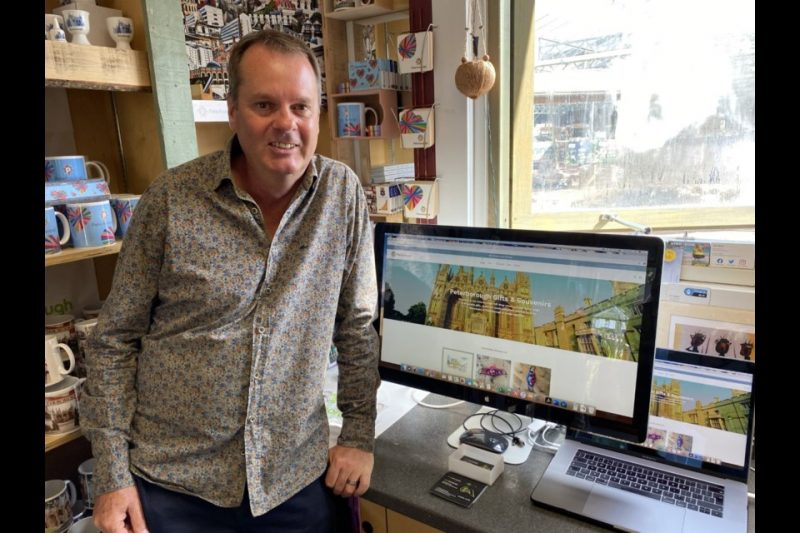 """A new website dedicated to selling work and souvenirs from Peterborough's artists has been launched,  Peterboroughgiftshop.comis the brainchild of Thorney-based artist Chris Lane and Peterborough Tourism Manager Tracy Snooks, and is perfect for those searching for Peterborough-based gifts online.  Posters, prints, cards, publications, jewellery and crafts are all on sale through the sitePeterboroughgiftshop.com  Chris, the person behind the website, said: """"More and more people are buying arts and crafts online. My company, Artinfusion. together with Tracy, the city's Tourism Manager, and Jackie Hall from the PAOS committee have been looking at other avenues to increase and outlets to offer not only Peterborough products but the great selection of artists that live and work in the city.""""  [caption id=""""attachment_10662"""" align=""""alignnone"""" width=""""600""""] Chris Lane, Artinfusion, has developed the peterboroughgiftshop.com[/caption]  """"The city has a vibrant arts' community and it's important that we continue to support our local artists in these challenging times by selling their work to a wider audience via the internet.""""  The online shop has already attracted a number of Peterborough Artists' Open Studios' members including Tony Nero, Kerry Richardson, Prue Pye and Sue Keen.  Kerry said """"I would usually sell my jewellery through Open Studios' events and other arts and crafts fairs across the country each year. This year has been different with many events being postponed or cancelled which was very disappointing. Becoming a seller on the Peterborough Gift Shop has provided me with a new outlet for my work and I've been really happy with the sales I've made so far.""""  There is no charge to become a seller or to set up your items on the online shop. You only pay 25% commission when an item is sold.  The Peterborough Gift Shop is designed for people who live in the PE (Greater Peterborough) postcode area. If you are interested in become a seller on the shop email chris@artinf"""